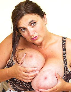 Horny Huge breasted mama playing with her pussy