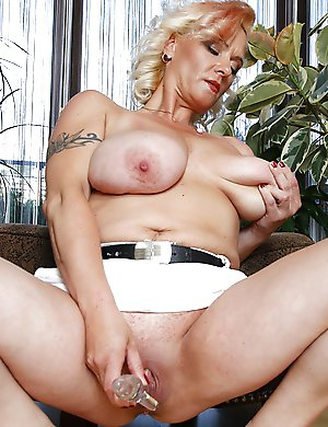 Big breasted MILF playing with herself